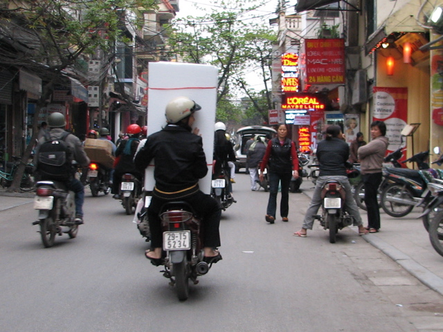 Carrying a fridge on a motorbike