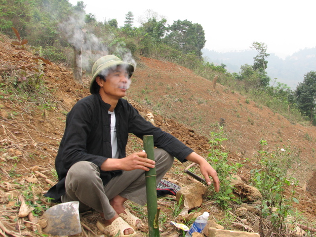Smoking from his bamboo water pipe