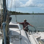 Steve at the helm. Negotiating shallows on the way to Gold Coast.